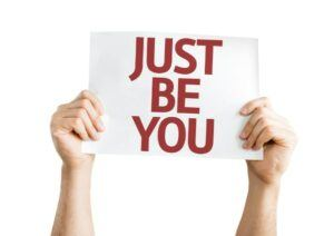 Hands Holding Up Sign that Says Just Be You
